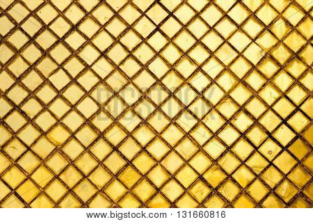 Golden square tiles pattern at buddhist temple Bangkok Thailand