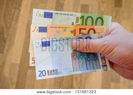 Euro Bank-notes In White Man Hand. Pay Bills With Money. Currency Concept. European Currency