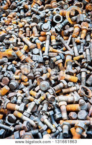 Rusty screws and screw nuts heap detail
