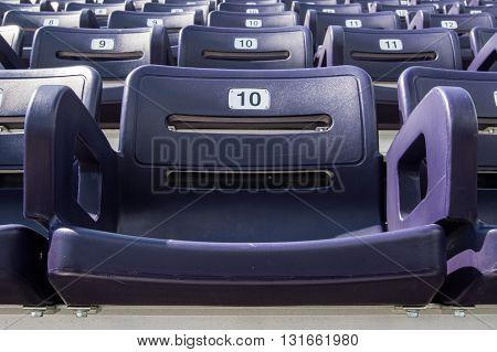 Single Purple Stadium Seat in sports arena