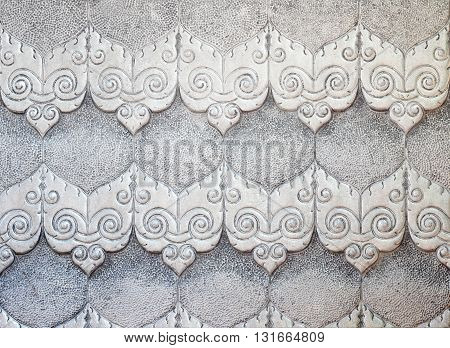 Aluminum Sheet pattern Crafts wall in the temple of thailand Lanna style Chiang Mai Thailand.