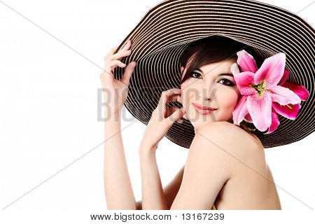 Shot of a young beautiful woman in elegant hat with a lily flowers. Isolated over white background.