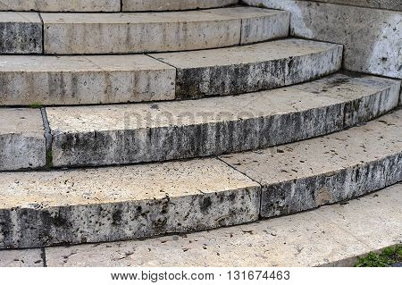 Old stone granite steps background closeup view
