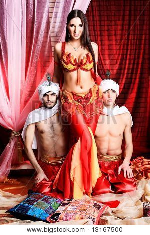 Shot of three young people in oriental costumes.