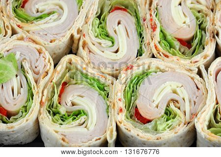 tortilla deli wrap rolls with ham vegetable isolated on white background