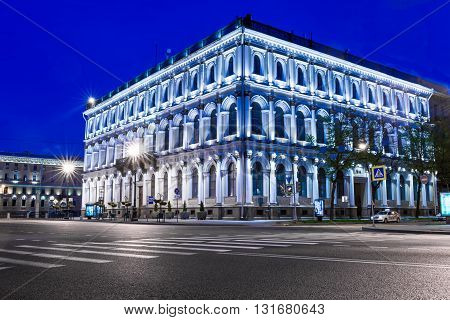 St. Petersburg Russia - May 20 2016: Nightview of ancient building on the corner of Big Morskaya street with taxi car in front.