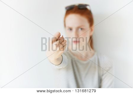 Selective Focus. Portrait Of Grumpy Angry Young Woman In Sailor Shirt Showing Fig Sign At The Camera