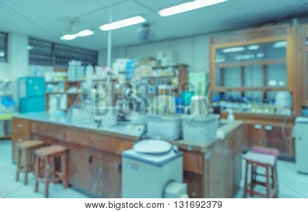 Blurred abstract background of workbench and equipment in chemistry laboratory. Scientific concept image