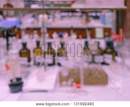 Blurred abstract background of untidy workbench in chemistry laboratory