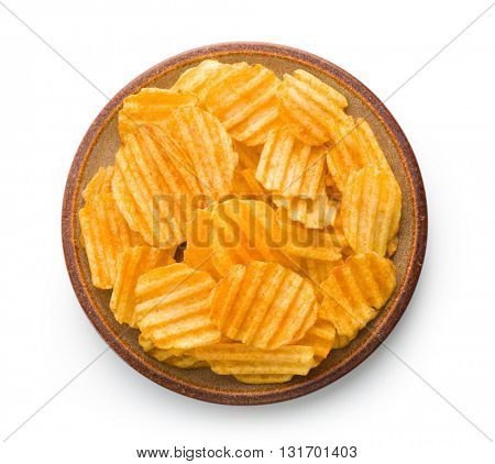 Crinkle cut potato chips isolated on white background. Tasty spicy potato chips on plate.