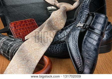 Classic blue shoes tie umbrella and briefcase on the wooden floor can be used as background