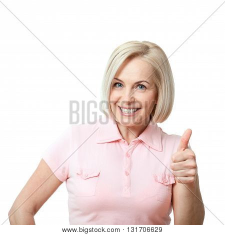 Happy attractive middle aged woman showing thumbs up okay. Isolated square