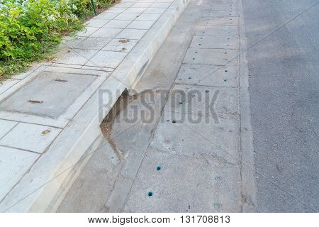 Drain Gutter In The Road, Next To Pavement