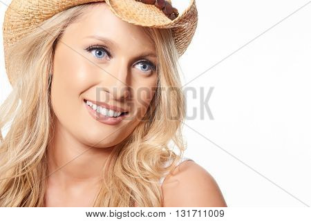 Portrait of beautiful blonde model with straw hat isolated on white