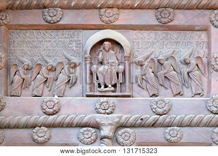 PISA, ITALY - JUNE 06, 2015: Christ in majesty on the San Ranieri gate of the Cathedral St. Mary of the Assumption in Pisa, Italy on June 06, 2015