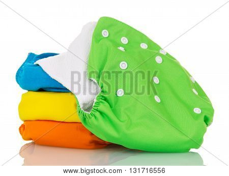 Organic cloth diapers isolated on white background.