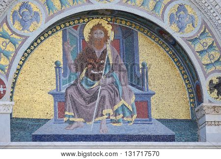 PISA, ITALY - JUNE 06, 2015: A colourful mosaic by Giuseppe Modena da Lucca, of the John the Baptist, lunette above right door of Cathedral in Pisa, Italy. Unesco World Heritage Site, on June 06, 2015