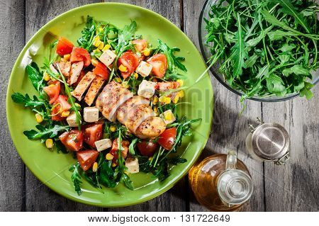 Fresh Salad With Chicken Breast, Arugula And Tomato