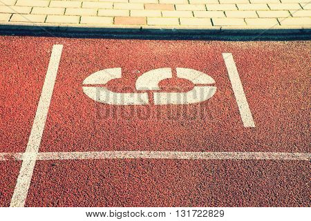 Number Six. White Athletic Track Number On Red Rubber Racetrack, Texture Of Running Racetracks In St