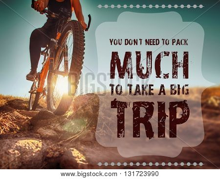 woman riding a bicycle down a dirt trail with rocks the country to get out of the city toned with a retro vintage filter effect with text: you don't need to pack much to take a big trip