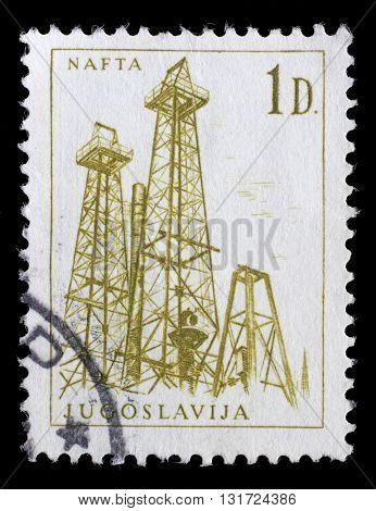 ZAGREB, CROATIA - JUNE 14: Stamp printed in Yugoslavia shows a Oil derricks, Nafta, with the same inscription, from series Industrial Progress circa 1966, on June 14, 2014, Zagreb, Croatia