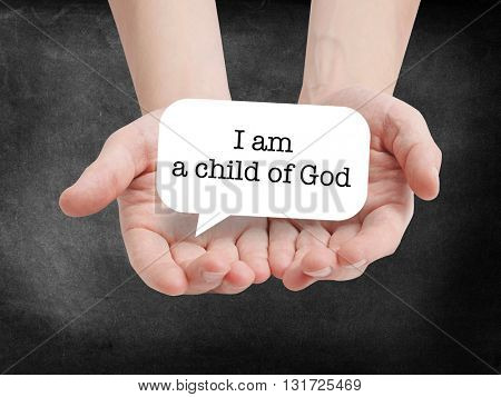 Child of god written on a speechbubble