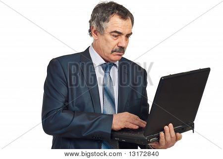 Middle Aged Executive Man Using Laptop
