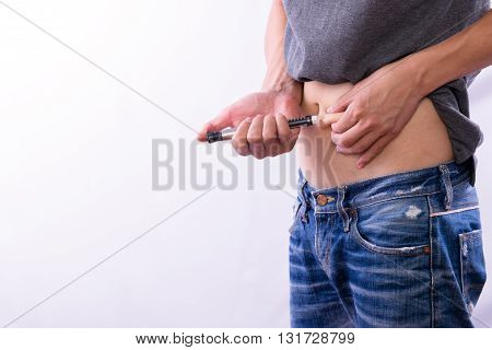Insulin injection for control blood sugar in type 1 diabetes on white background with copy space