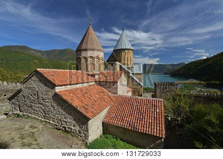Ananuri fortress complex on the Aragvi River in Georgia. Castle is situated near beautiful lake and surrounded with green mountains.