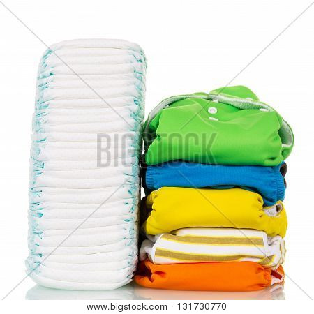 Stacks of disposable and reusable diapers tissue isolated on white background.