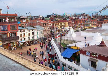 KATHMANDU, NEPAL - OCTOBER 03, 2008: People circles around the Boudhanath stupa in Kathmandu, Nepal. The Boudhanath stupa is the holiest Buddhist landmark in Nepal and UNESCO site since 1979
