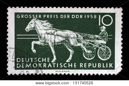 ZAGREB, CROATIA - JULY 02: a stamp printed in GDR shows Trotter, Race Horse, International Horse Racing, Berlin, circa 1958, on July 02, 2014, Zagreb, Croatia