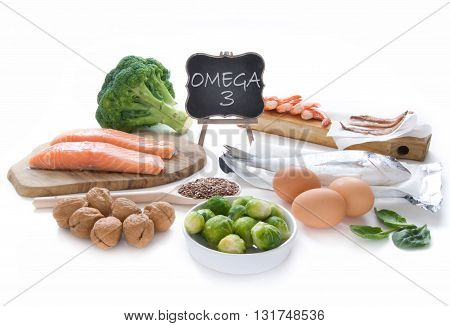 Collection of foods high in fatty acids omega 3 including seafood vegetables and seeds over a white background