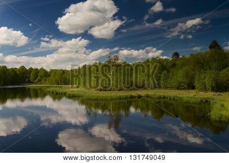 Clouds reflecting at the Lake Rotes Moor Rhoen Hessen Germany