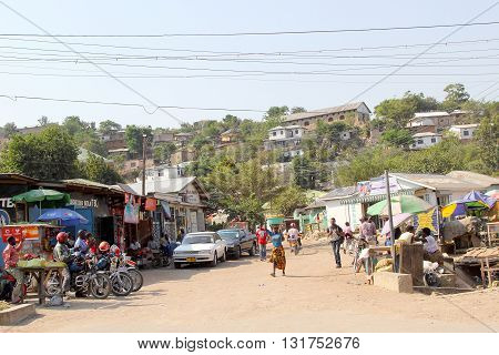 MWANZA TANZANIA - JUNE 11: people in a small market along one of the main road of the town on June 11 2013 in Mwanza
