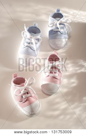 TWO PAIRS OF A BABY BOY'S AND A GIRL'S LITTLE CUTE SHOES