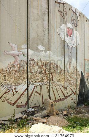 BETHLEHEM, ISRAEL, 2 APRIL 2013. Editorial photograph of Peace Dove graffiti on Israeli Separation Wall