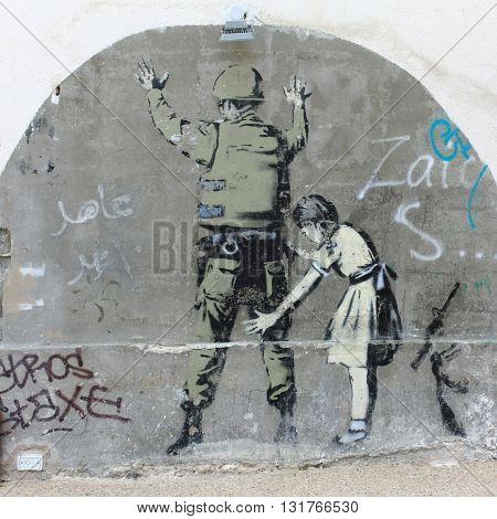 BETHLEHEM, ISRAEL, 2 APRIL 2013. Banksy Graffiti near Separation Wall at the North End of Manger Street