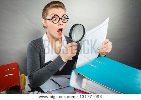 Shocked Secretary Examining Documents.