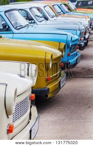 Berlin Germany - May 15 2016: rows of Trabant cars. It was most common vehicle in the former GDR. After reunification it becames a symbol of former East Germany and of the fall of Eastern Bloc