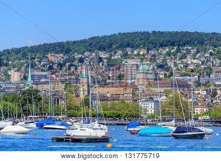Zurich, Switzerland - 26 May, 2016: boats on Lake Zurich city of Zurich in the background. Lake Zurich (German: Zurichsee) is a lake in Switzerland extending southeast of the city of Zurich. Zurich is the largest city in Switzerland.