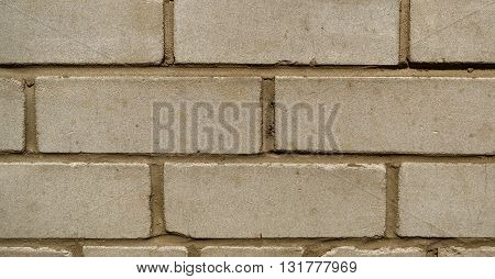Wall from a silicate brick of newly built house, brickwork, background, texture
