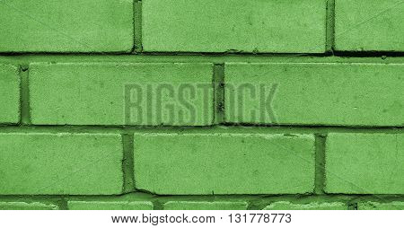 Wall from a silicate brick of newly built house, brickwork, background, green