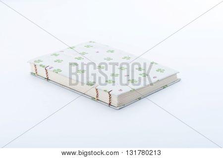Closeup of handmade book on white background