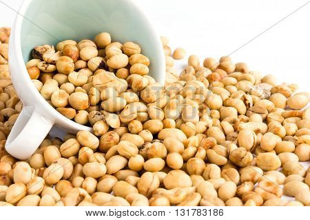 unroasted coffee beans isolated on white background