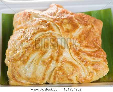 close up of omelet in Thai style food