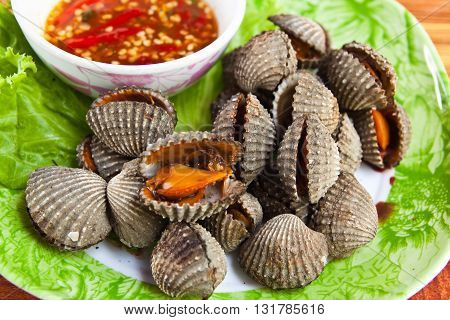 close up of cockles grill Thai style seafood