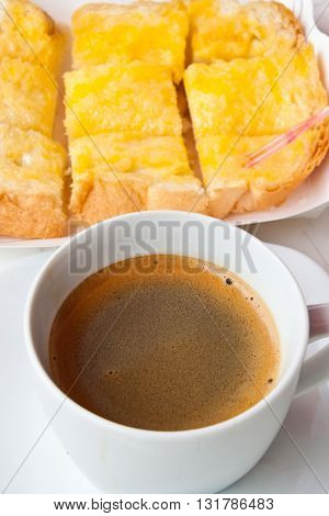 Breakfast with coffee and bread on the table