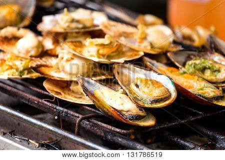 close up of grilled mussels on the grate