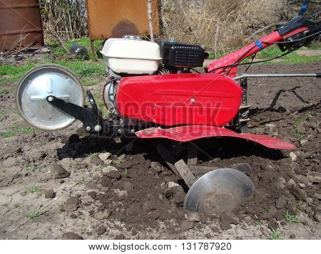 manual tillers for land cultivation by mechanical means.